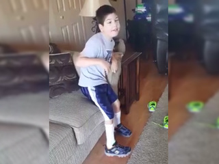 Boy with cerebral palsy stands for natl. anthem