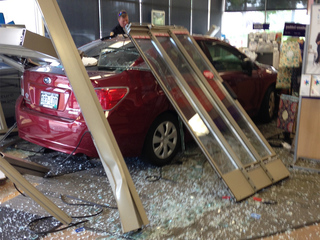 Car crashes 15-feet into Highlands Ranch FedEx