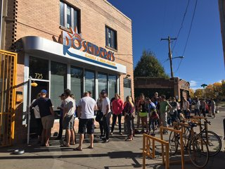 Popular bagel shop reopens after May fire