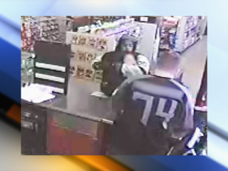 Woman grabbed by armed robber at store