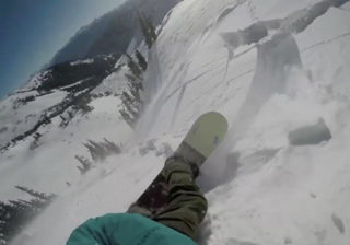 WATCH: Snowboarder caught in avalanche