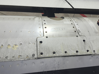 Frontier jet flies with missing screws on wing