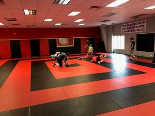 Wrestling club partners with online school
