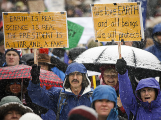 The snow didn't stop the Climate March in Denver
