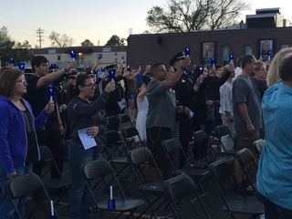 Fallen officers honored with candlelight vigil