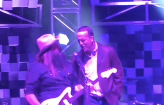 Peyton Manning joins Chris Stapleton on stage