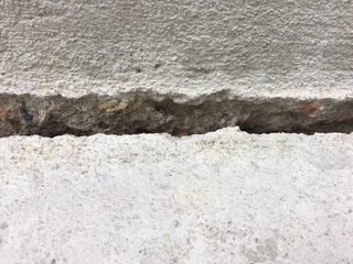 Cracked, sinking concrete plague new homeowners