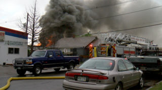 Brighton tire shop fire destroys 3 businesses