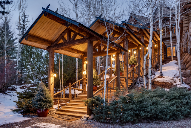 snowmass tall and md all vacations garge book garage colorado aspen entrance cabins lodge timbers