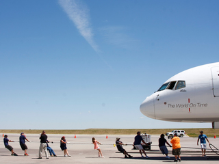 Athletes benefit from airport Plane Pull