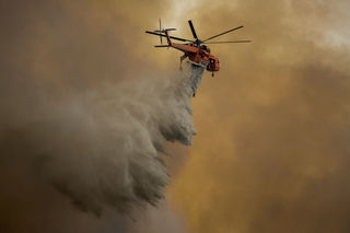 Wildfires across US West force evacuations