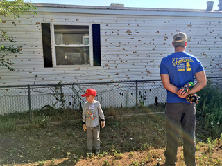 Volunteers repair 50 hail-damaged homes