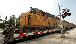 Colo. woman unharmed after train rolls over her