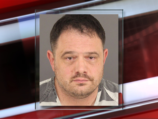 Denver deputy charged with weapons threat