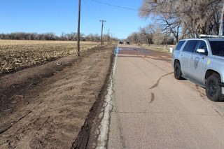Pedestrian killed east of Evans; drivers sought