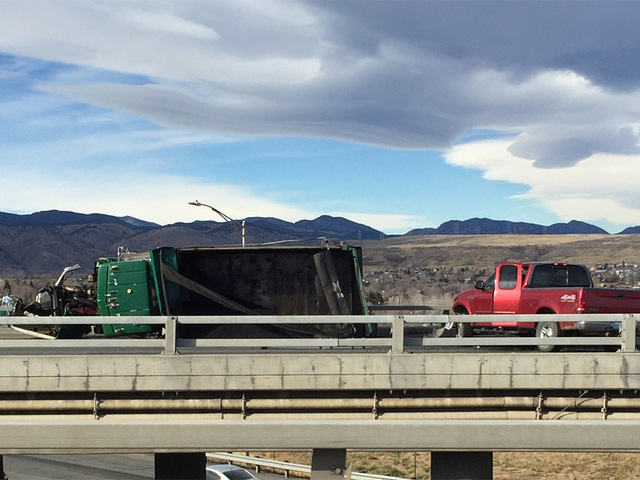 Overturned dump truck shuts down I-70 at 6th Avenue