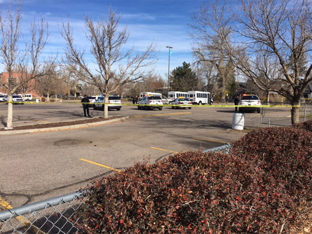 Three 'SHOT at school vehicle park' with gunman at large
