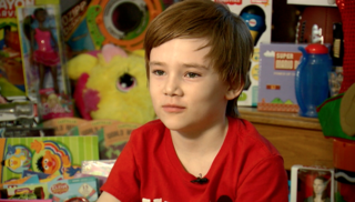 8-year-old boy paying it forward with toy drive