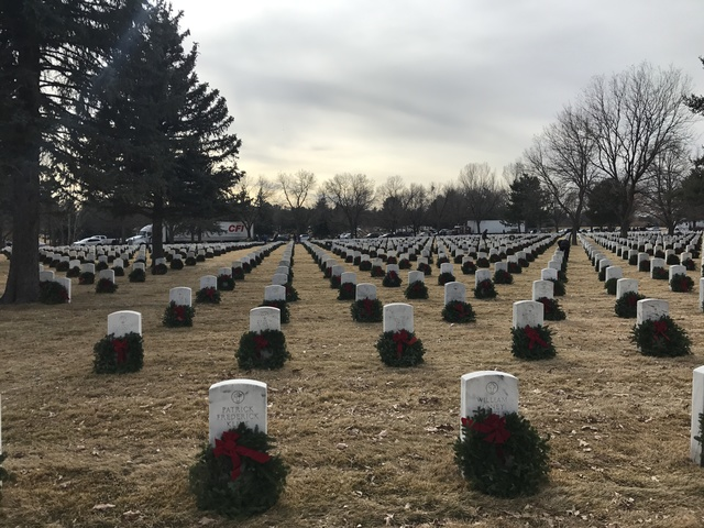 Wreaths laid on headstones at Ft. Logan cemetery