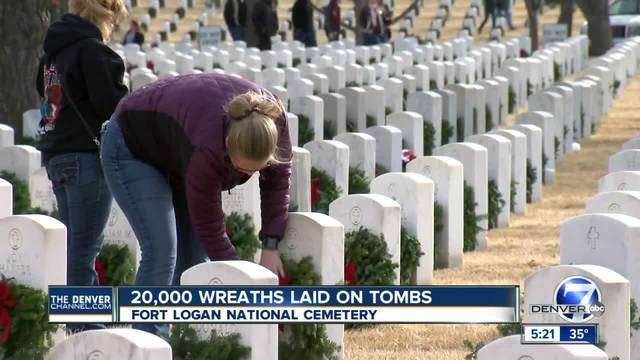 Thousands of Christmas wreaths laid on headstones at Fort Logan National…