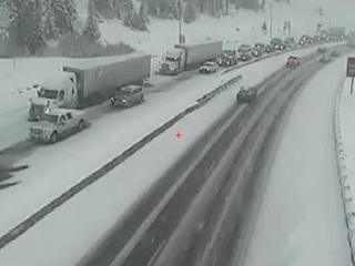 Snow, icy roads slow traffic across Front Range