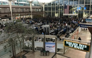 DIA gears up for busiest holiday travel day