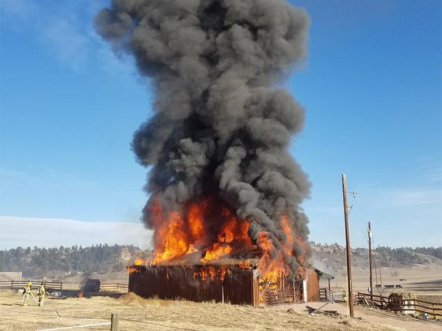 Crews battling barn fire in Franktown