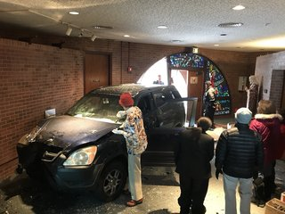 SUV crashes through doors of Denver church