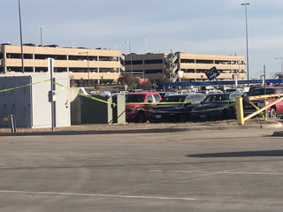 Body found outside DIA parking garage