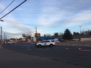 2 killed, woman injured in parking lot shooting