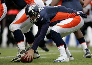 Paige: Broncos can't forget past in picking QB