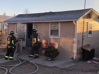 Man sets house on fire during police standoff