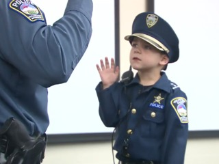 4-year-old with cancer becomes police officer