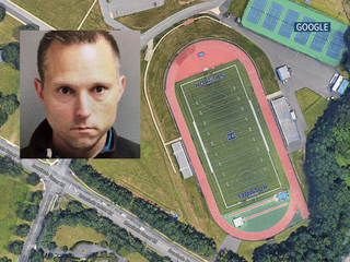 School's chiefaccused of pooping on track