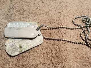Man finds WWII dog tags, returns them to family