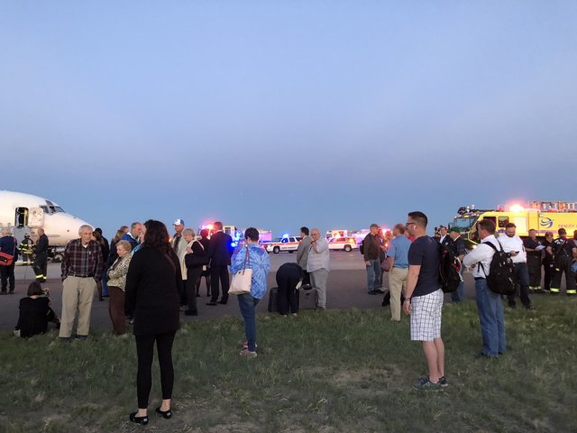 Smoke forces passengers to evacuate plane in Denver