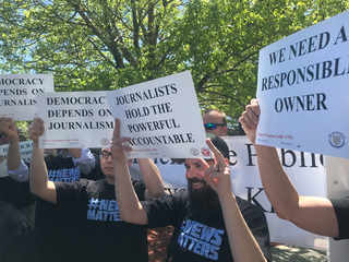 Post reporters, staff members protest owners