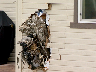 Engine from plane crash blasts into Parker home
