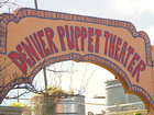 Who steals puppets from a kids theater?