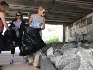 Volunteers cleanup trash on Denver urban trails