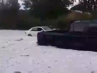 Woman rescued from 'arctic river' of hail, rain