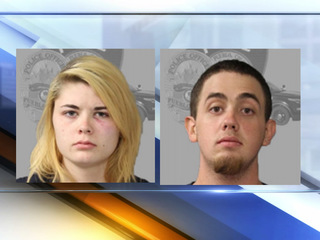 Two charged with child abuse after infant dies