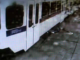 Denver RTD light rail camera shows man dragged