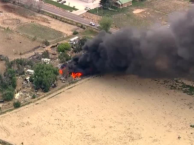 Large fire burning near Commerce City