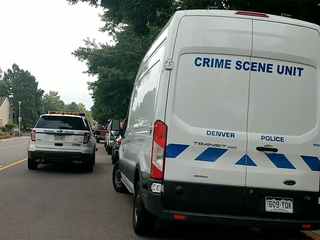 1 dead in SE Denver robbery shooting; 2 at large