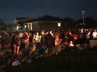 Candlelight vigil honors Watts family