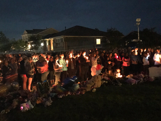 Candlelight vigil honors Watts family