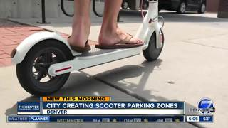 Denver to start painting scooter parking spots