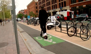 Cyclists and scooter riders learn to share space