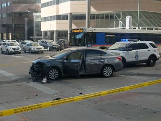 Crash involving 2 cars and pedestrian in Denver